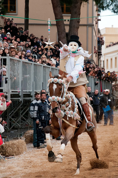 "Oristano (Italy), 21.02.2012 - Sartiglia festival (Gremio dei Falegnami), the most important carnival of Sardinia. The ""Su Componidori"", leader of the show, tries to pick up the star with ""su stoccu"", a particular wooden sword."
