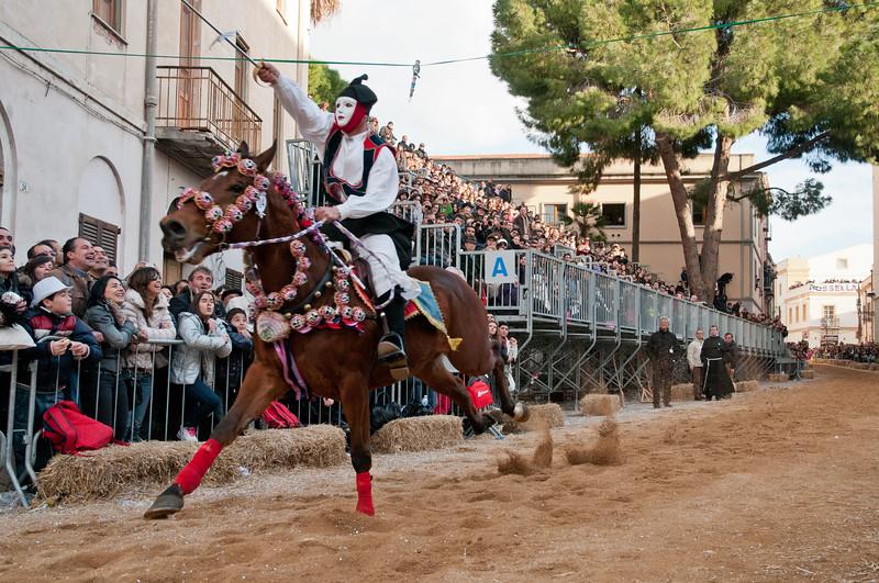 """Oristano (Italy), 21.02.2012 - Sartiglia festival (Gremio dei Falegnami), the most important carnival of Sardinia. A moment of the """"Corsa alla Stella"""" race. The horseman gets the star."""
