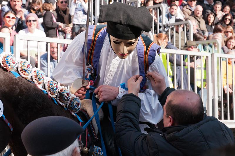 """Oristano (Italy), 21.02.2012 - Sartiglia festival (Gremio dei Falegnami), the most important carnival of Sardinia. A horseman  rewarded after he took the star in the """"Corsa alla stella"""" race."""