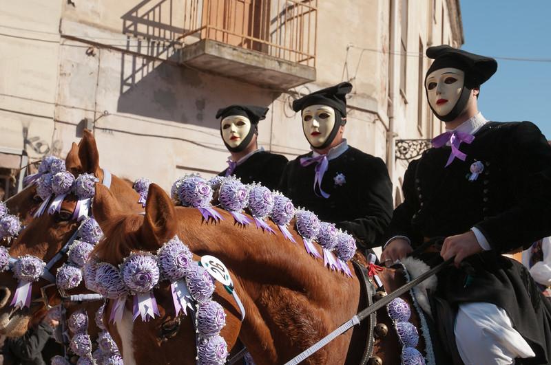 Oristano (Italy), 21.02.2012 - Sartiglia festival (Gremio dei Falegnami), the most important carnival of Sardinia. Cavaliers wearing mask and traditional carnival dress.
