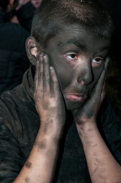 """Ottana: festa di Sant'Antonio Abate. Bambini si """"mascherano"""" il viso con la cenere come da tradizione.  EDITORIAL USE ONLY - SOLO USO EDITORIALE."""
