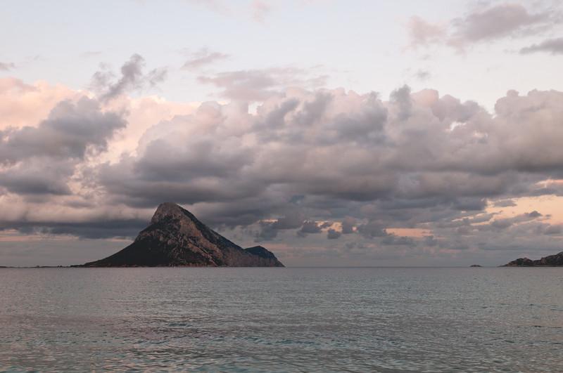Sunset at Porto Taverna beach, near San Teodoro, Nort-eastern coast of Sardinia. Tavolara Island on background.