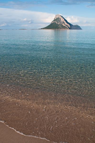 Sardinia, Italy: Porto San Paolo, Porto Taverna beach and Tavolara island at sunset.