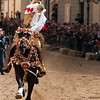 "Sardinia, Italy: Oristano, Sartiglia festival. A moment of the ""Palio della Stella"" horse race. The ""Su Componidori"", leader of the festival, tries to take the star with his sword. Un momento della Corsa alla Stella organizzata dal Gremio dei Contadini di San Giuseppe."