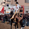 "Sardinia, Italy: Oristano, Sartiglia festival. Palio della stella horse race. The crowd acclaim the ""Su Componidori"" after he took the star. La folla applaude Su Componidori dopo aver preso la stella."