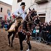 """Sardinia, Italy: Oristano, Sartiglia festival. Palio della stella horse race. The crowd acclaim the """"Su Componidori"""" after he took the star. La folla applaude Su Componidori dopo aver preso la stella."""