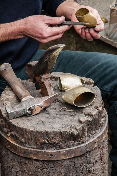 The town of Tonara is famous forthe hand made bells, which is used for traditional costumes ornament. (IT) Il paese di Tonara è famoso per la realizzazione dei campanacci che vengono usati per i costumi delle maschere tradizionali sarde.