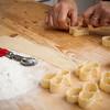 Preparazione di dolci tipici sardi fatti in casa: le origliettas, fatte con la stessa pasta delle piu' famose seadas ma senza ripieno. Questi dolci vengono fritti e successivamente coperti con il miele caldo. Possono prendere diverse forme.