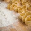 """Sardinia, Italy: making of typical sardinian desserts """"origliettas"""" - Sardegna, preparazione di dolci tipici sardi fatti in casa, le """"origliettas""""."""