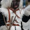 Sardinia, Italy: traditional carnival masks - Maschere tradizionali della Sardegna: bambino con il costume dei sos Corriolos di Neoneli
