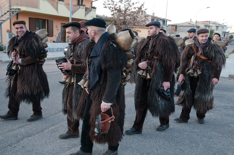 Mamoiada, Italy - 17.01.2012. Celebration of fuochi di Sant'Antonio Abate (St. Anthony Abate's Fires). Men clad in Issohadores and mamuthones outfit dance with other revellers in Mamoiada village near Nuoro, Sardinia Island in Italy. The Carnival of Mamoiada is among the oldest folkloric manifestation in Sardinia. Everyone's attention is focused on the parade of the Mamuthones and Issohadores, Sardinia's most renowned masks.