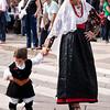 Sardinia, Italy: Sassari, Cavalcata Sarda Festival. A woman wearing a traditional sardinian dress with her child. Cavalcata Sarda: sfilata dei costumi tradizionali della Sardegna
