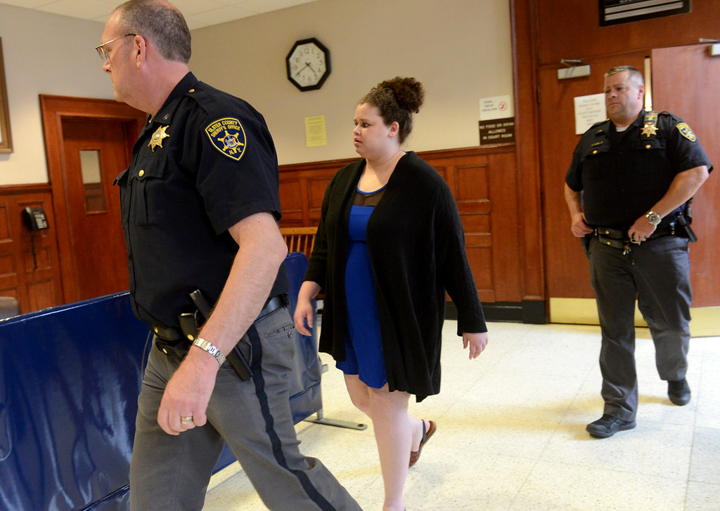 . Tania Barricklo- Daily Freeman  Sarra Gilbert is escorted out of the courtroom Thursday afternoon.