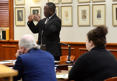 Tania Barricklo- Daily Freeman  Assistant District Attorney Emmanuel Nneji questions the medical examiner during Thursday's court proceedings about slashes found on the victim Mari Gilberts hands.