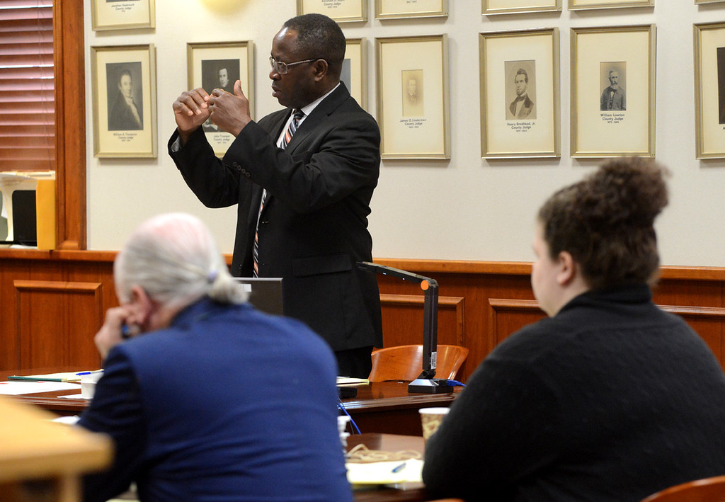 . Tania Barricklo- Daily Freeman  Assistant District Attorney Emmanuel Nneji questions the medical examiner during Thursday\'s court proceedings about slashes found on the victim Mari Gilberts hands.