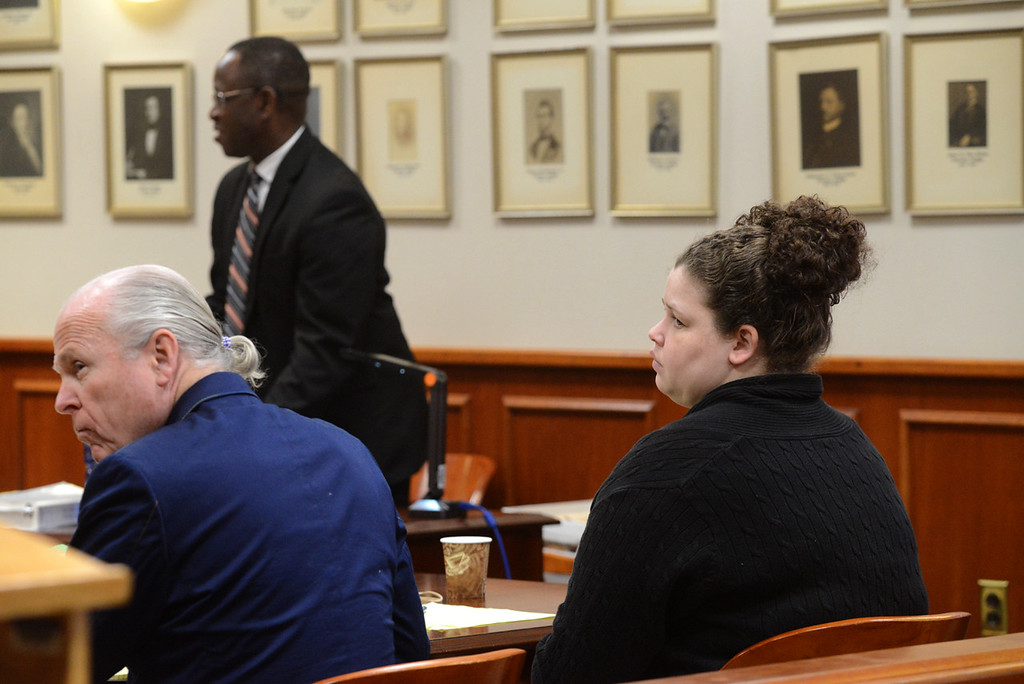 . Tania Barricklo-Daily Freeman                      Sarra Gilbert, right, sits with her defense attorney John Ray, left , during  Thursday\'s court proceedsngs during the murder trial of Gilberts mother Mari. In hte rear is Assistant District Attorney Emanuel Nneji.