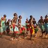 Samburu dance on the banks of a dry riverbed in Samburu northern Kenya