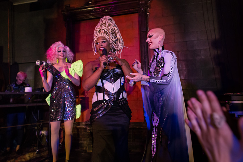 Peppermint and Olive d'Nightlife share a moment on stage with currently reigning queen Sasha Velour.