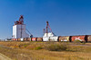 A grain elevator with railroad grain cars near Langenburg, Saskatchewan, Canada.