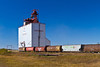 A grain elevator with railroad grain cars near Langenburg, Saskatchewan, Canada.