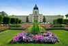 Formal flower gardens and the Saskatchewan Provincial legislative buildings in Regina, Saskatchewan, Canada.