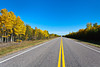Highway 106 in north-central Saskatchewan with fall foliage color in the forests.