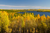 Sealy Lake with fall foliage color along Highway 106 in rural Saskatchewan, Canada.