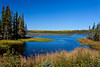 A small roadside marsh with fall foliage color along Highway 106 in Saskatchewan, Canada.