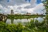 The city skyline and reflections in the South Saskatchewan River at Saskatoon, Saskatchewan, Canada.