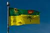 The Saskatchewan provincial flag with blue sky.