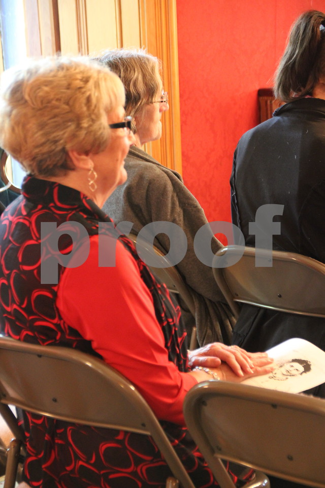 """On Sunday, October 2, 2016 the Vincent House in Fort Dodge held an event called """"Sassy Ladies of The West"""". Stories about ladies of the West were told by a guest speaker, to those in attendance. Afterward there were refreshments served. Pictured here( in red and black) is: Mary Conrad."""