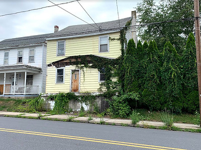 Christine Lee / Staff Photo Advanced Consulting Inc. has owned the property at 273 W. Main St. in Ringtown since 2019 and has been cited by borough officials for lack of maintenance. Borough officials brought legal action against the company over the building in September 2020. Pictured July 8, 2021.