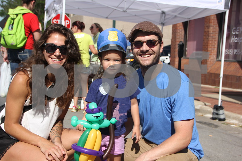 Market On Central took place on Saturday, July 9, 2016 in Fort Dodge. Pictured here is the Doughty family.  Left to right is: Jordi, Olive(little girl), and Ryne, who stopped to pose for a picture.