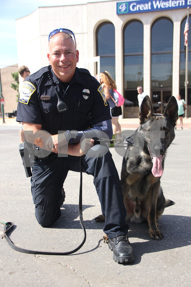 Market On Central took place on Saturday, July 9, 2016 in Fort Dodge. Pictured  is: Officer Paul Samuelson and dog in K-9 officer training, Ren, who were on hand at the event.
