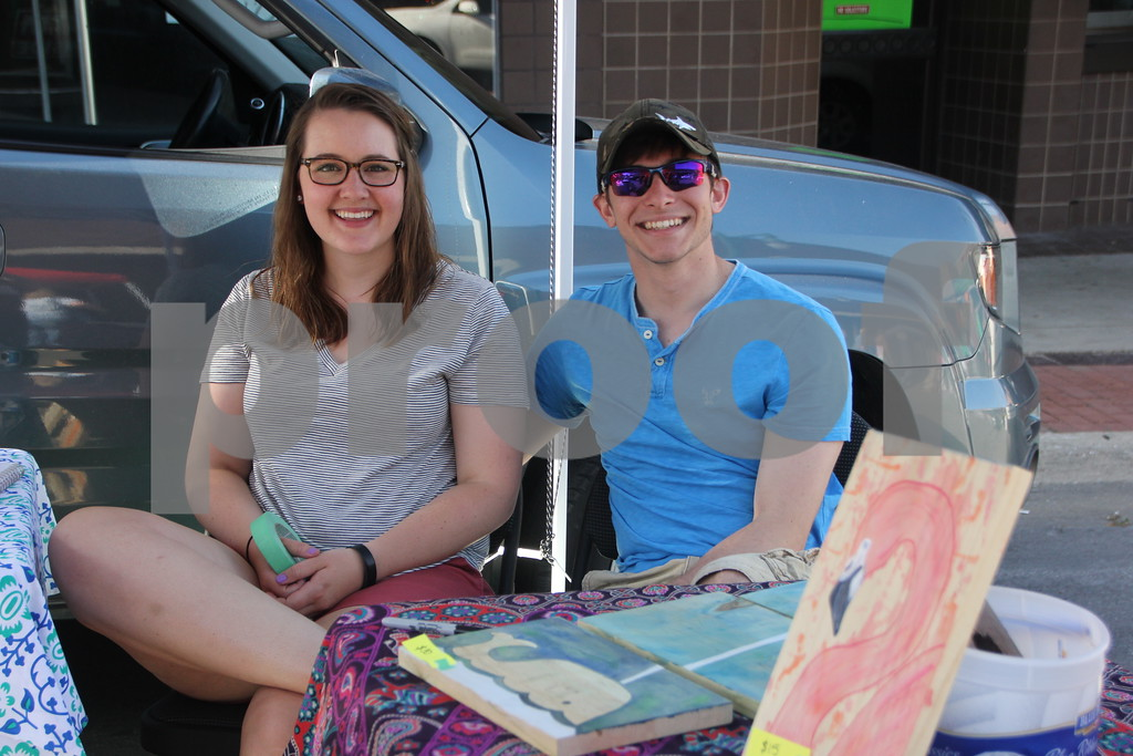 Market On Central took place on Saturday, July 9, 2016 in Fort Dodge. Seen here (left to right) is: Kjerstin Grinberg and Calvin Brandt, one of several vendors at the event. This was their second appearance in the event.