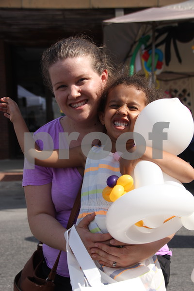 Saturday, June 11, 2016, Central Avenue in Fort Dodge held the Market On Central. Pictured left to right is: Jill and ( little girl) Maiya Herndon checking out the wares available at the event.