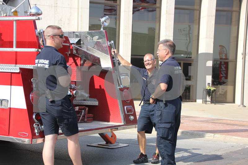 Saturday, June 11, 2016, Central Avenue in Fort Dodge held the Market On Central. In addition to the vendors and attendees at the event, members of  the Fort Dodge Fire Department were present to  display the huge flag from the fire engine and  educate people in fire safety, etc. Shown left to right here  are: Matt Newton, Nick Carlson, and Loren Helgevold.