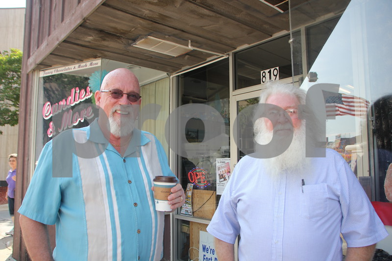 Saturday, June 11, 2016, Central Avenue in Fort Dodge held the Market On Central.  While checking out everything available at the event, these two gentleman stopped long enough to get their picture taken. Seen left to right is: Dr. Richard Votta and Gary Edgerton.