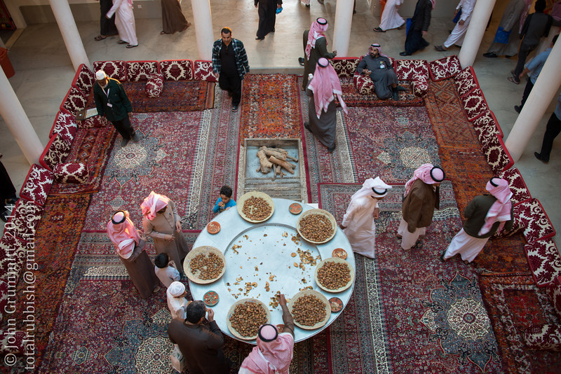 Visitors help themselves to dates in the Qassim date pavilion