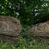 Stone angles sitting in the grass by Kahlenberg Chapel