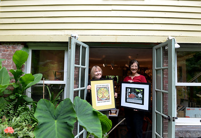 Tania Barricklo-Daily Freeman                       Prudence See, left, an artist in the Saugerties Art Tour  and Barbara Bravo, and artist and organizer stand in the doorway of See's stidio on Burt St. in the village of Saugerties.