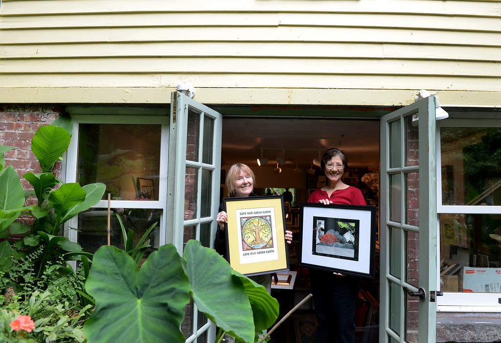 . Tania Barricklo-Daily Freeman                       Prudence See, left, an artist in the Saugerties Art Tour  and Barbara Bravo, and artist and organizer stand in the doorway of See\'s stidio on Burt St. in the village of Saugerties.
