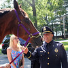Saugus,. Ma. 7-18-17. Lieutenant Detective David Gecoya, Saugus Police, meeting with a police horse that will be name after him, and called L. T. for short and sent to his new assignment in Washington D. C. as a U. S. Parks Police Horse as part of the Horses & Heros Foundation.