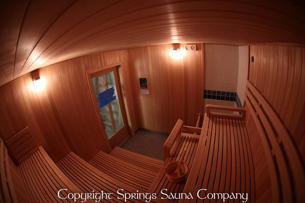 Custom sauna in Chattanooga, TN (industrial) - ADA-accessible<br /> *Hemlock paneling vertically<br /> *Custom bench levels<br /> *Custom bench depths<br /> *Custom foot-rest guard rail<br /> *Standard backrests