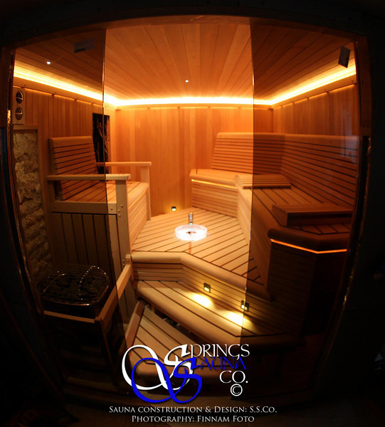 Sauna on Staten Island in New York City:<br /> *Hemlock paneling vertically<br /> *Half-round bench fascia<br /> *2x4 bench tops<br /> *Contoured 'Captain's Chair'<br /> *Custom slanted backrest<br /> *Low-voltage strip lighting<br /> *LED step lights<br /> *Under-lit embedded crystal glass bowl<br /> *Brizo faucet with wooden handle<br /> *Fiber optic spot lighting with 8 colors<br /> *4 bench levels<br /> *Lighting embedded into the leading edge of the upper benches<br /> *Custom bench skirting