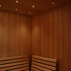 Sauna on Manhattan in New York City:<br /> *Hemlock paneling vertically<br /> *Standard benches<br /> *Custom slanted backrests<br /> *Fiber optic spot lighting