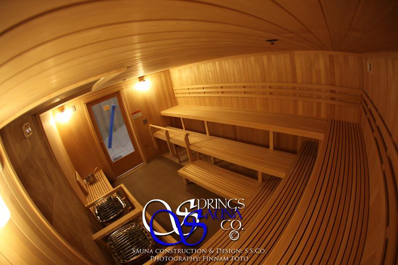 Sauna for the Air Force in Little Rock, AR (Jacksonville)<br /> *Vertical Hemlock paneling<br /> *Custom 3 bench levels<br /> *ADA-accessible <br /> *Custom footrest guard rail<br /> *Custom heater guard<br /> *Custom casing and crown molding<br /> *Standard backrests<br /> *Standard light fixtures