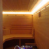 Sauna in Glenwood Springs, CO:<br /> *Hemlock paneling horizontally<br /> *Custom no-trim-molding-treatment<br /> *Low-voltage strip lighting<br /> *Standard benches in custom angles<br /> *Custom heater guard & Footrest<br /> *TV-screen<br /> *Custom corner shelf<br /> *Standard backrests