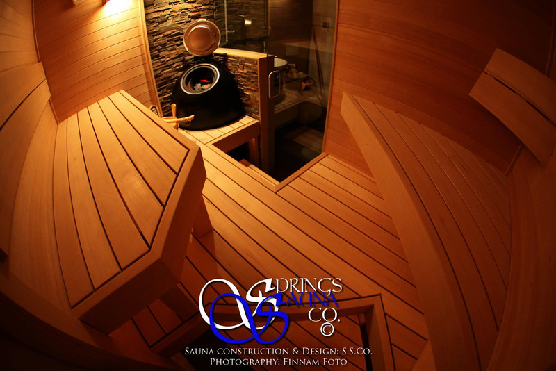 Sauna in Sunnyvale, CA:<br /> *Hemlock paneling horizontally (still over furring strips, though)<br /> *Custom wall-to-wall middle platform<br /> *3 bench levels<br /> *2x4 bench tops<br /> *2x6 bench fascia<br /> *Ripped 2x6 backrest<br /> *Ropelighting under upper bench<br /> *Standard wall sconce with wooden shade<br /> *Spot light over heater to illuminate steam