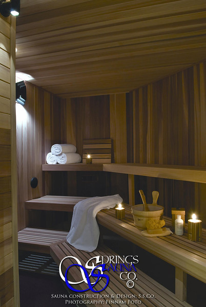 """Sauna in Larkspur, CO - """"Mountain Living"""" magazine's first """"Natural Dream Home"""":<br /> *Western Red Cedar vertically<br /> *Custom columns around heater<br /> *Custom heater guard<br /> *Custom wall sconces<br /> *Custom step lights<br /> *Standard benches on 3 levels"""